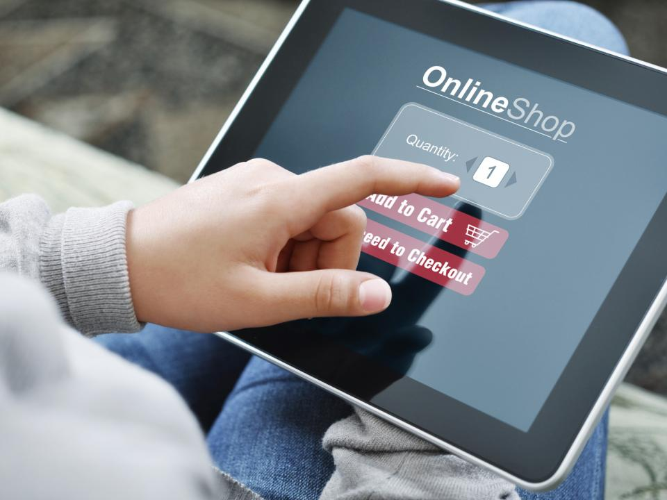 Person shopping online using an iPad