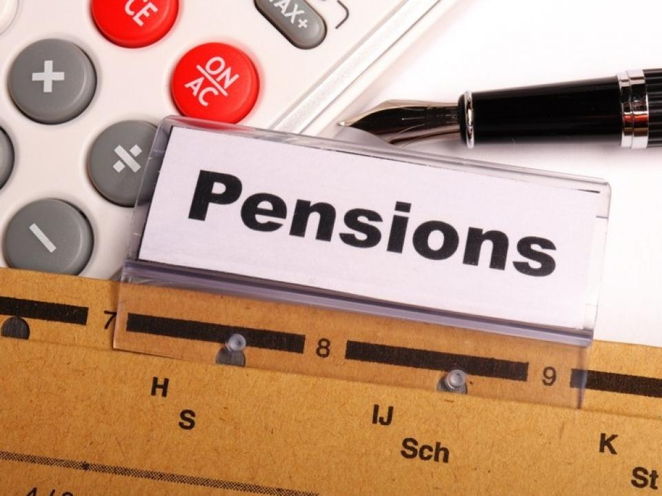 The word pensions is displayed on the screen beside a pen and a calculator