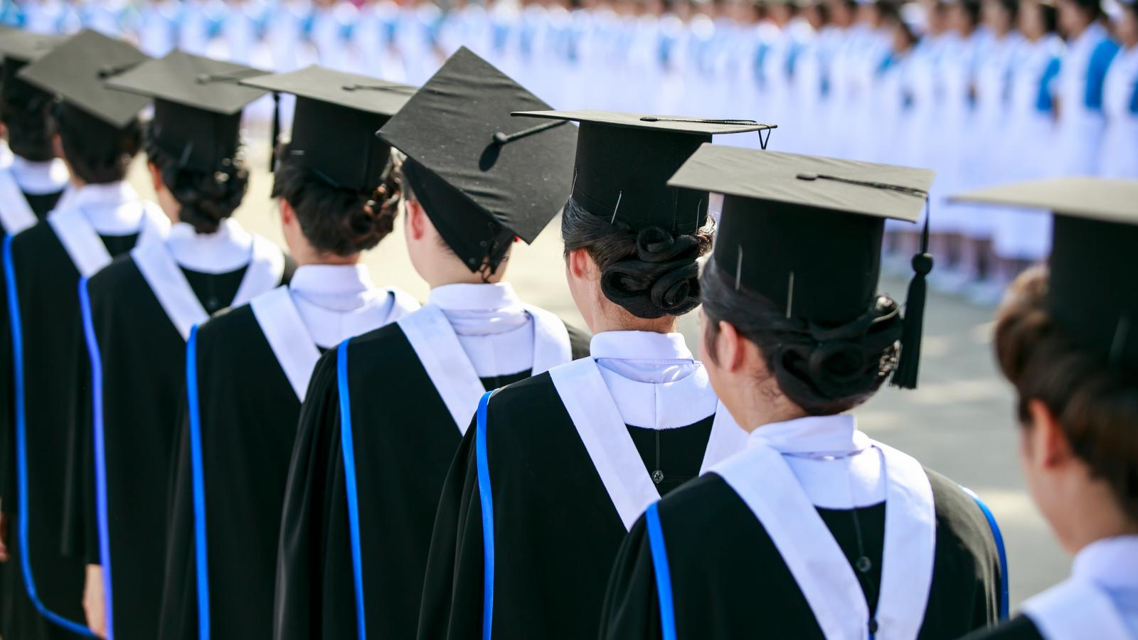Line of graduates in caps and gowns
